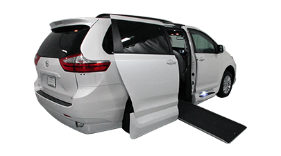 White Toyota Genesis handicap van with side entry conversion